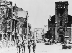 Troops Walking by Demolished Buildings